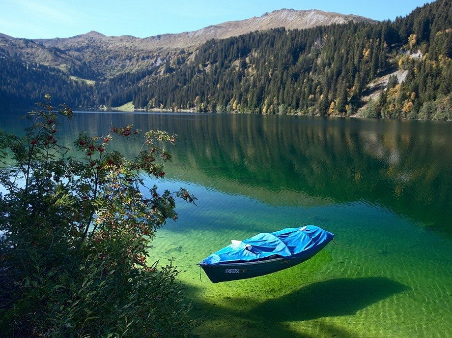 The boat looks like it is floating in the air because the water is so clear!